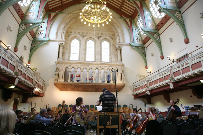 The orchestra rehearsing in the town hall